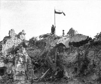 Polish flag flying over the ruins of conquered Monte Cassino monastery, May 1944. Polish Flag Monte Cassino3.jpg