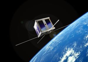 Computer simulated image of AAU CubeSat in orb...