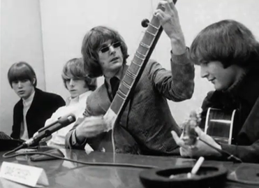 "The Byrds hosting their ""raga rock"" press conference for the release of ""Eight Miles High"" in March 1966 The Byrds Raga Rock.png"