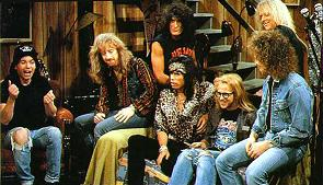 "Aerosmith appear in a ""Wayne's World"" sketch on Saturday Night Live in 1990. Aerosmith WaynesWorld.jpg"