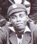A headshot of a man in a cricket cap