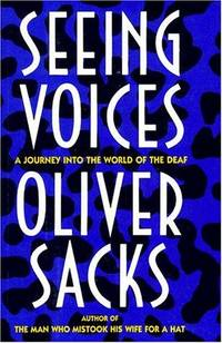 "A book cover with text saying ""Seeing Voices A Journey Into The World Of The Deaf Oliver Sacks Author of The Man Who Mistook His Wife For A Hat"" on a blue and black background"