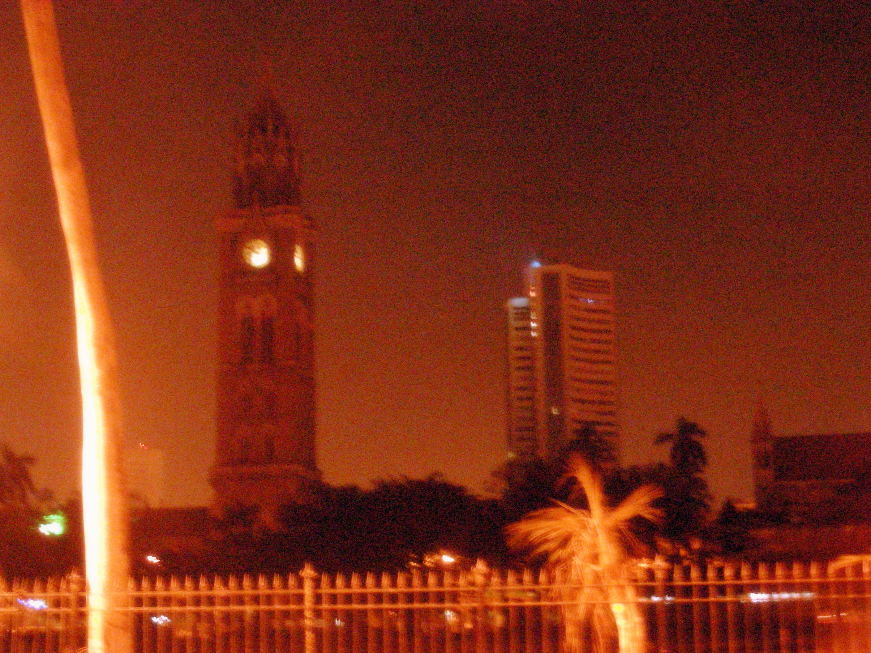 Rajabai Tower and Phiroze Jeejeebhoy towers by night.