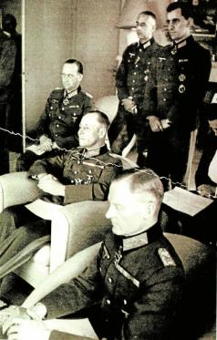 A meeting between the military resistance's inner circle and Rommel, Mareil-Marly, 15. May 1944. From left, Speidel - behind, Rommel - center, von Stulpnagel - front. The officer standing left is Rudolf Hartmann. The others are unknown. A meeting between the military resistance's inner circle and Rommel, Mareil-Marly, 15. May 1944.jpg