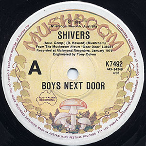 "A close-up image of the label of a 7-inch gramophone record. Block black text reads ""A, Shivers, Boys Next Door""."