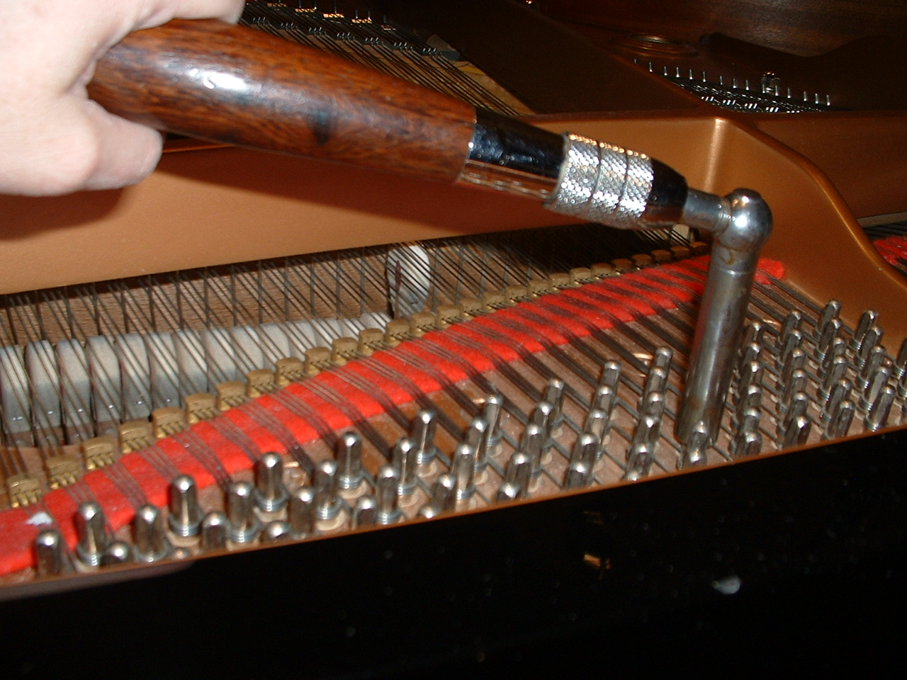 file piano tuning lever that is on a tuning pin with hammer striking a string in an acoustic. Black Bedroom Furniture Sets. Home Design Ideas