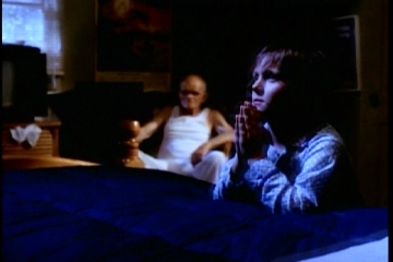 Screenshot of the music video in which a child is seen reciting a prayer while being watched by Sandman. EnterSandmanvideo.jpg
