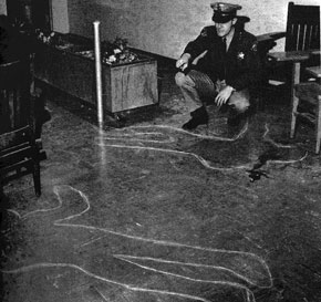 LAPD officer views chalk outlines of the bodies of John Huggins and Bunchy Carter.