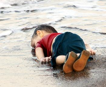 Photo of Alan Kurdi's lifeless body on a beach by Nilüfer Demir from DHA Agency (Turkey)