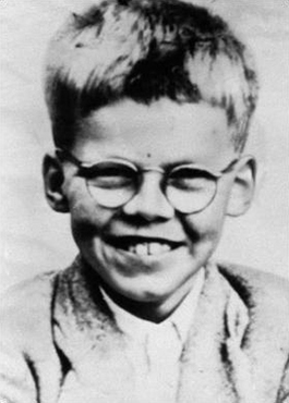 Young boy wearing spectacles