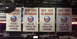 These four banners hung in Nassau Veterans Memorial Coliseum and represent the four Stanley Cup championships the Islanders won from 1980 through 1983.