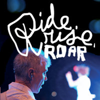 "The backside of David Byrne's head turns to face the camera and in the background, a woman is dancing in a white uniform. Above them is written ""Ride, rise, ROAR"" in a white font that imitates handwriting."