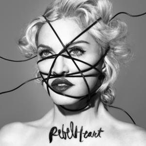 Black-and-white image of Madonna's face, with black strings going criss-cross over it