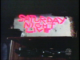 The title card for the eleventh season of Saturday Night Live.