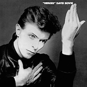 The album cover features a black and white photograph of Bowie's face with his hands held up
