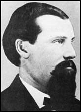 B&W image of a man with short hair and a long goatee beard