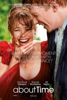A girl in a red dress, laughing in the rain, alongside a tall red-haired man wearing a suit.
