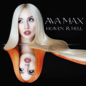 A reflection of Max is displayed on a black background; she is seen with blonde hair on top, as well as with orange hair underneath.