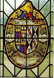 English heraldic stained glass by Thomas Willement showing his own arms and motto.