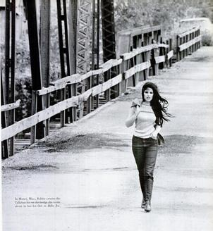 In this photograph from the November 10, 1967 issue of Life magazine, Bobbie Gentry crosses the Tallahatchie Bridge in Money, Mississippi. The bridge collapsed in June 1972.[7]