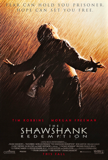 "A man stands with his back to the viewer and his arms outstretched, looking up to the sky in the rain. A tagline reads ""Fear can hold you prisoner. Hope can set you free."""