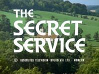 "The title ""The Secret Service"", rendered in a bold, white, serif font, is superimposed above an image of a church set against a rural background of tree-lined hills bathed in bright sunlight."