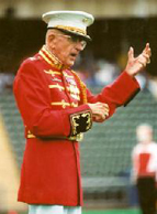 Col. Truman Crawford conducting the USMC Drum and Bugle Corps.