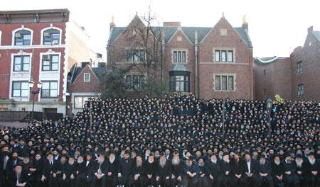 A photo of the shluchim outside 770.