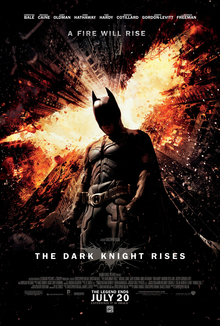0c161569 The Dark Knight Rises. Batman standing in Gotham with a flaming bat symbol  above