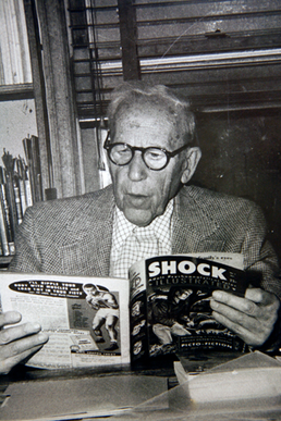 Wertham reading a comic book.