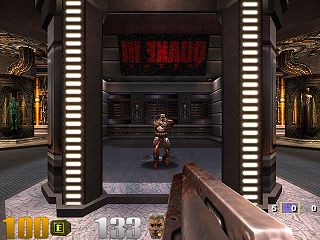 A mirror reflects Sarge and the Quake III logo in the opening scene of the first level, Q3DM0.
