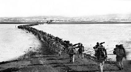 Chinese forces cross the frozen Yalu River. China Crosses Yalu.jpg