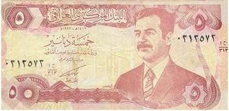 A Five Dinar Banknote With An Image Of Former Iraqi President Saddam Hussein