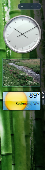 Windows Vista's sidebar, showing analog clock, picture slideshow, and current weather of Redmond, WA.