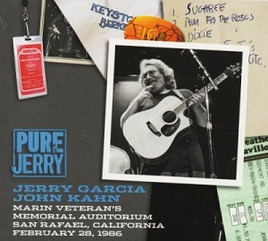 """A photo of Jerry Garcia on stage with an acoustic guitar, an orange guitar pick with a """"JGB"""" design, a hand-written set list, a Merriweather Post Pavilion ticket stub, a Keystone Berkeley napkin, two photos of Jerry Garcia as a stage magician conjuring a guitar from out of a hat, and a backstage pass for the Jerry Garcia Band"""