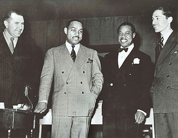 Carter stands with Robert Goffin, Louis Armstrong, and Leonard Feather in 1942. Robert Goffin, Benny Carter, Louis Armstrong, Leonard Feather 1942.jpg