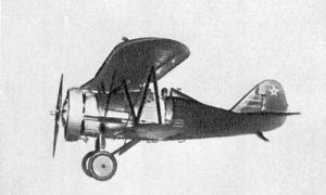 A radial-engined biplane with a metallic forward fuselage, the wings and rear fuselage covered by fabric with the ribs visible