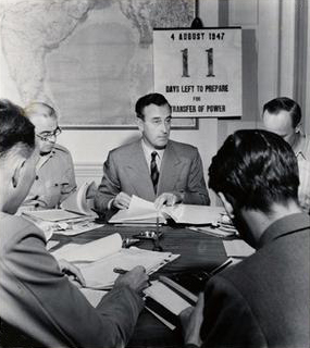 Mountbatten with a countdown calendar to the Transfer of Power in the background Mountbatten 4 august 1947.jpg