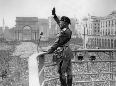 Mussolini was initially a highly popular leader in Italy until Italy's military failures in World War II Benito Mussolini Roman Salute.jpg