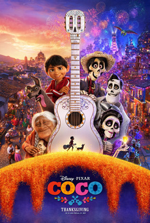 "Theatrical release poster depicting the characters Coco, Dante the dog, Miguel, Héctor, Ernesto, and Imelda when viewing clockwise from the bottom left around Ernesto's white, Day of the Dead-styled guitar. The guitar has a calavera-styled headstock with a small black silhouette of Miguel, who is carrying a guitar, and Dante at the bottom. The neck of the guitar splits the background with their village during the day on the left and at night with fireworks on the right. The bottom of the poster has the film's logo and release date of ""Thanksgiving""."