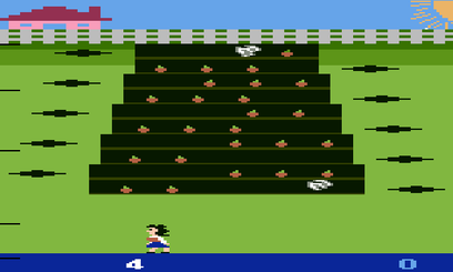 An Atari game depicting a carrot patch and a girl standing below it.