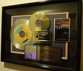 The RIAA gold record award. Change the World Gold Record.jpg