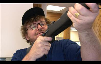 bowling columbine essay Michael moore's oscar-contender documentary, bowling for columbine, pokes  fun at corporate creeps and hypocrites in his crusade to figure.