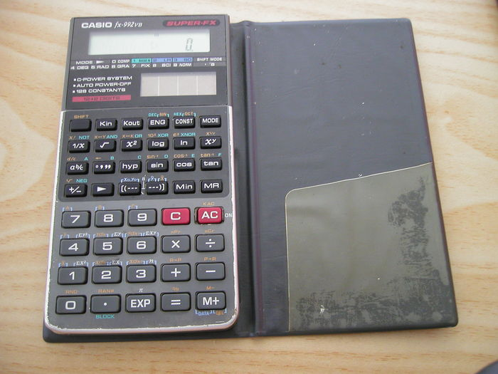 Casio FX-992VB, a scientific calculator from the late 1980s, uses solar power together with a button cell