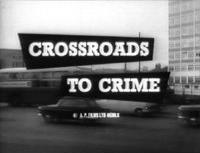 "A black-and-white shot of a road filled with cars and buses, in front of background buildings, has the title ""Crossroads to Crime"" superimposed in the centre"