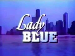 "A cityscape, with the title ""Lady Blue"" superimposed on it"