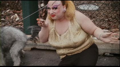 The scene at the end of Pink Flamingos, in which Divine (in character as Babs Johnson) consumes fresh dog feces, became a significant part of American cinema history and dominated discussion of Divine and Waters' films for decades to come. Divine eating feces.jpg