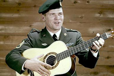 "Sadler during 1969, performing the ""Ballad of the Green Berets"" with his guitar"