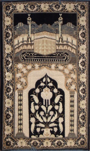 Typical manufactured prayer mat showing the Kaaba
