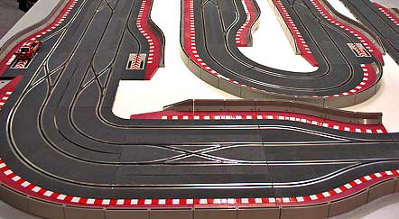digital track scx 1995 digital technology allows cars to change lanes at crossing points and passing lane sections